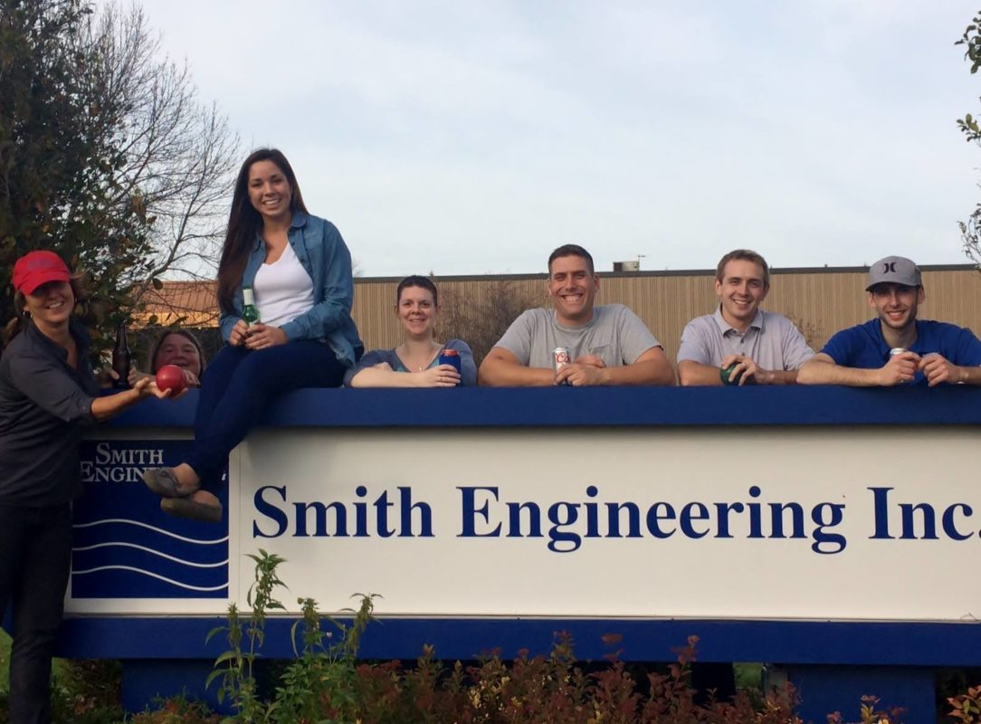 Smith Sign with Employees